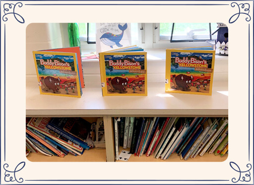 Buddy Bison books on bookshelf