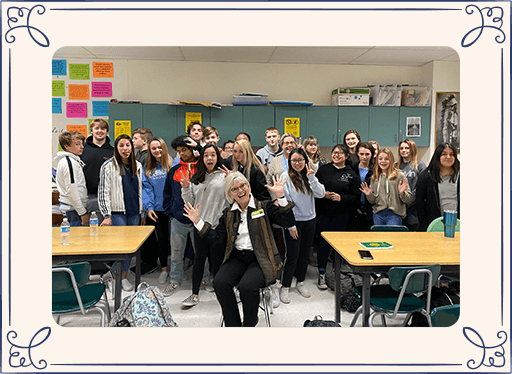 Dr. Holland and high school kids in a classroom making silly faces