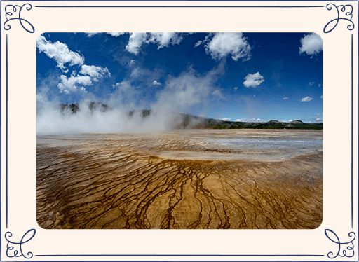 Photo of steam coming from the earth at Yellowstone National Park